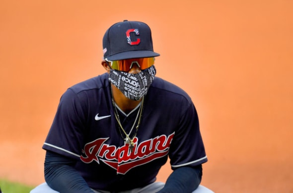 Francisco Lindor of the Cleveland Indians warms up on the field wearing a face mask prior to an intrasquad game during summer workouts at Progressive Field.