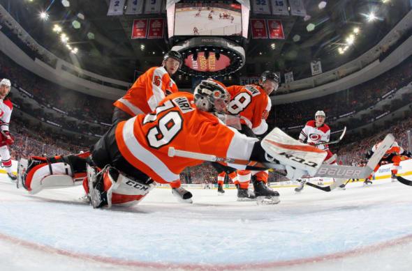 Flyers goalie Carter Hart scrambles to make a save against the Carolina Hurricanes