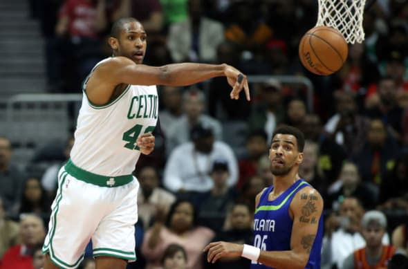 Jan 13, 2017; Atlanta, GA, USA; Boston Celtics center Al Horford (42) passes out of the defense of Atlanta Hawks forward Thabo Sefolosha (25) in the first quarter of their game at Philips Arena. Mandatory Credit: Jason Getz-USA TODAY Sports