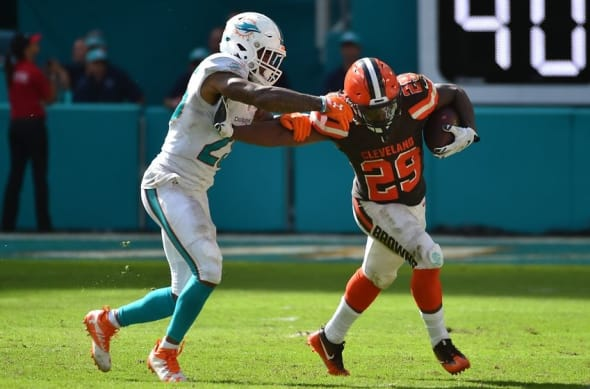 Sep 25, 2016; Miami Gardens, FL, USA; Cleveland Browns running back Duke Johnson (29) stiff arms Miami Dolphins cornerback Xavien Howard (25) during the second half at Hard Rock Stadium.The Miami Dolphins defeat the Cleveland Browns 34-20 in overtime. Mandatory Credit: Jasen Vinlove-USA TODAY Sports
