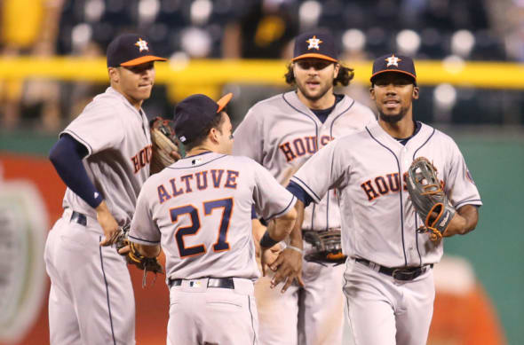 Aug 22, 2016; Pittsburgh, PA, USA; Houston Astros shortstop Carlos Correa (L) and second baseman Jose Altuve (27) and center fielder Jake Marisnick (RC) and left fielder Teoscar Hernandez (R) celebrate after defeating the Pittsburgh Pirates at PNC Park. The Astros won 3-1. Mandatory Credit: Charles LeClaire-USA TODAY Sports