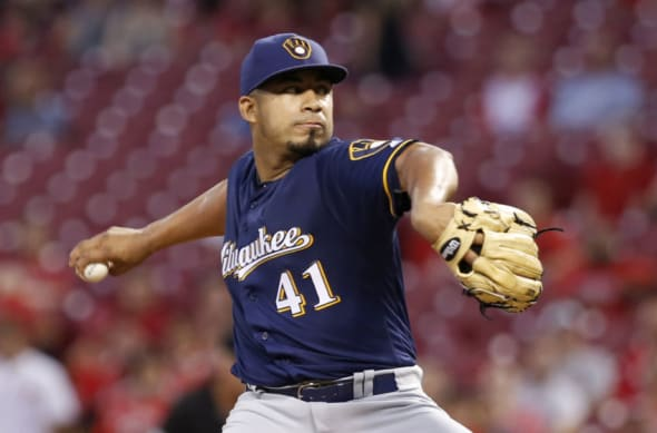 Sep 14, 2016; Cincinnati, OH, USA; Milwaukee Brewers starting pitcher Junior Guerra throws against the Cincinnati Reds during the second inning at Great American Ball Park. Mandatory Credit: David Kohl-USA TODAY Sports