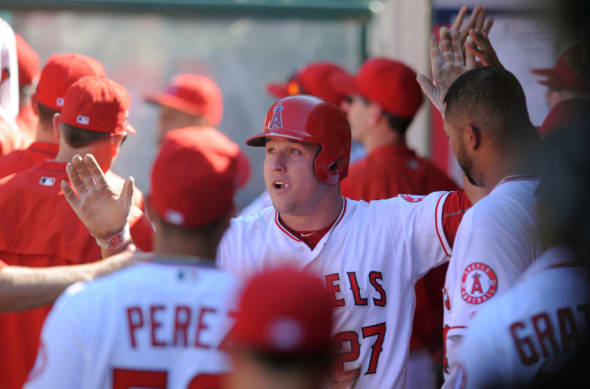 September 18, 2016; Anaheim, CA, USA; Los Angeles Angels center fielder Mike Trout (27) is greeted after scoring a run in the seventh inning against Toronto Blue Jays at Angel Stadium of Anaheim. Mandatory Credit: Gary A. Vasquez-USA TODAY Sports