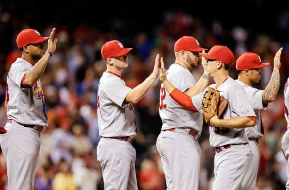 Sep 19, 2016; Denver, CO, USA; St. Louis Cardinals right fielder Stephen Piscotty (55) celebrates with teammates following the game against the Colorado Rockies at Coors Field. The St. Louis Cardinals won 5-3. Mandatory Credit: Isaiah J. Downing-USA TODAY Sports