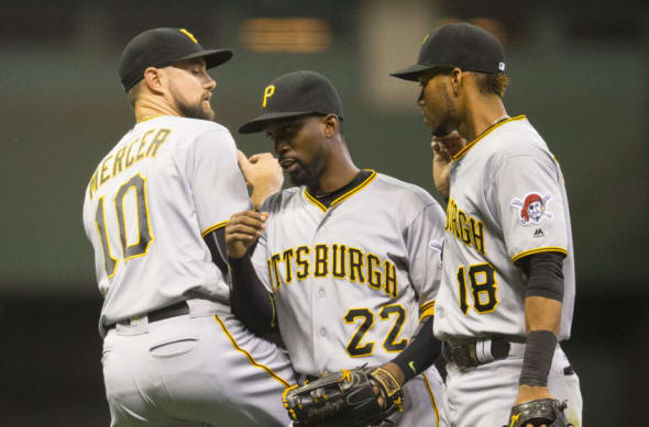 Sep 21, 2016; Milwaukee, WI, USA; Pittsburgh Pirates shortstop Jordy Mercer (10), center fielder Andrew McCutchen (22) and shortstop Pedro Florimon (18) celebrate following the game against the Milwaukee Brewers at Miller Park. Pittsburgh won 4-1. Mandatory Credit: Jeff Hanisch-USA TODAY Sports
