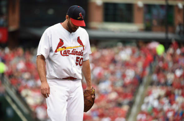 Oct 2, 2016; St. Louis, MO, USA; St. Louis Cardinals starting pitcher Adam Wainwright (50) walks off the field after getting the final out of the fifth inning against the Pittsburgh Pirates at Busch Stadium. Mandatory Credit: Jeff Curry-USA TODAY Sports