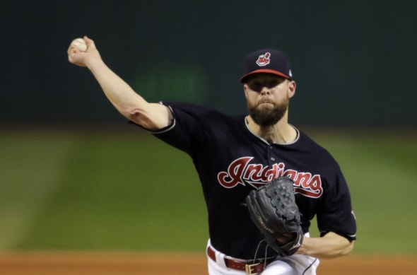 Nov 2, 2016; Cleveland, OH, USA; Cleveland Indians starting pitcher Corey Kluber throws a pitch against the Chicago Cubs in the first inning in game seven of the 2016 World Series at Progressive Field. Mandatory Credit: Gene J. Puskar/Pool Photo via USA TODAY Sports
