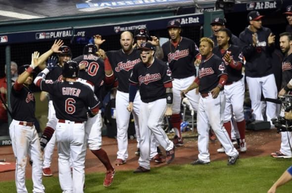 Nov 2, 2016; Cleveland, OH, USA; Cleveland Indians center fielder Rajai Davis (20) celebrates with teammates after hitting a two-run home run against the Chicago Cubs in the 8th inning in game seven of the 2016 World Series at Progressive Field. Mandatory Credit: David Richard-USA TODAY Sports