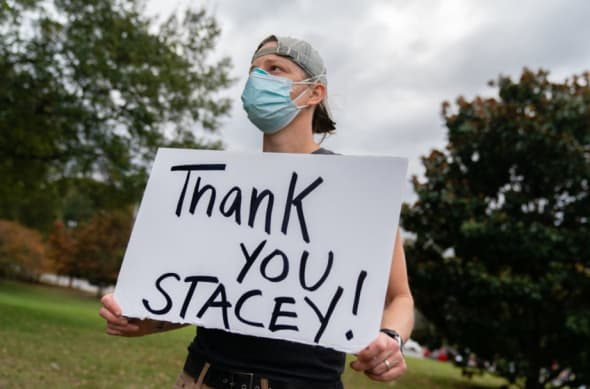 voter with sign thanking Stacey Abrams