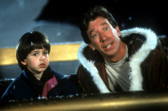 Tim Allen with a child in a scene from the film 'The Santa Clause', 1994. (Photo by Walt Disney Pictures/Getty Images)