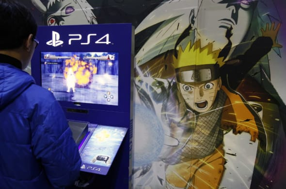 PARIS, FRANCE - FEBRUARY 06: A visitor plays the video game Naruto shippuden : Ultimate Ninja Storm 4 developed by Bandai Namco Games on a games console Sony Playstation PS4 at Paris Manga