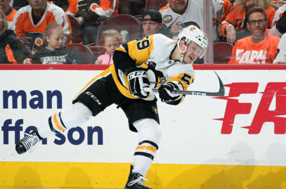 PHILADELPHIA, PA - APRIL 15: Jake Guentzel #59 of the Pittsburgh Penguins takes a slapshot against the Philadelphia Flyers in Game Three of the Eastern Conference First Round during the 2018 NHL Stanley Cup Playoffs at the Wells Fargo Center on April 15, 2018 in Philadelphia, Pennsylvania. (Photo by Len Redkoles/NHLI via Getty Images)