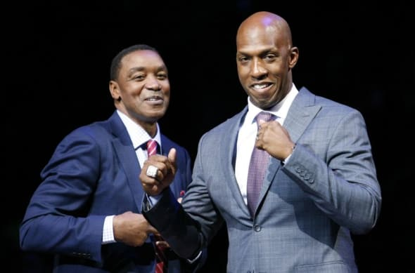 Feb 10, 2016; Auburn Hills, MI, USA; Chauncey Billups walks by Isiah Thomas during his halftime retirement ceremony in the game between the Detroit Pistons and the Denver Nuggets at The Palace of Auburn Hills. The Nuggets won 103-92. Mandatory Credit: Raj Mehta-USA TODAY Sports