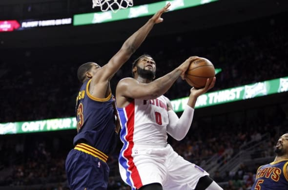Apr 24, 2016; Auburn Hills, MI, USA; Detroit Pistons center Andre Drummond (0) takes a shot against Cleveland Cavaliers center Tristan Thompson (13) during the second quarter in game four of the first round of the NBA Playoffs at The Palace of Auburn Hills. Mandatory Credit: Raj Mehta-USA TODAY Sports