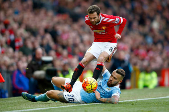 MANCHESTER, ENGLAND - OCTOBER 25: Juan Mata of Manchester United is tackled by Nicolas Otamendi of Manchester City during the Barclays Premier League match between Manchester United and Manchester City at Old Trafford on October 25, 2015 in Manchester, England. (Photo by Clive Rose/Getty Images)