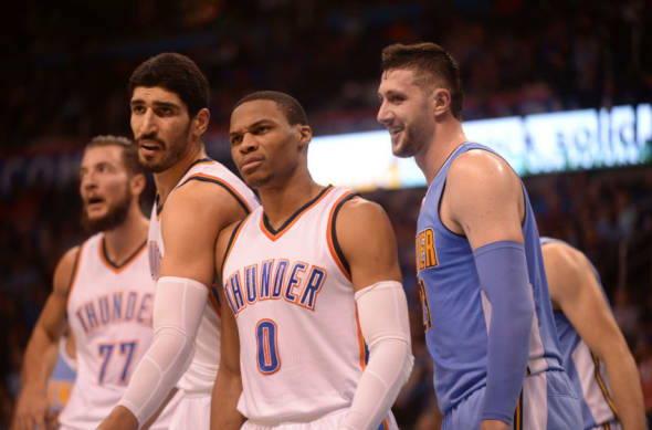 Oct 18, 2016; Oklahoma City, OK, USA; Oklahoma City Thunder guard Russell Westbrook (0) and Oklahoma City Thunder center Enes Kanter (11) react to a call as Denver Nuggets center Jusuf Nurkic (23) looks on during the second quarter at Chesapeake Energy Arena. Mandatory Credit: Mark D. Smith-USA TODAY Sports