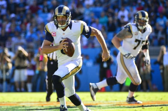 Oct 20, 2013; Charlotte, NC, USA; St. Louis Rams quarterback Sam Bradford (8) runs with the ball and is injured on the play against the Carolina Panthers at Bank of America Stadium. Mandatory Credit: Bob Donnan-USA TODAY Sports