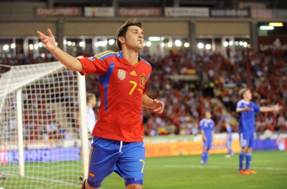 LOGRONO, SPAIN - SEPTEMBER 06: David Villa of Spain celebrates after scoring Spain's 6th goal during the EURO 2012 Qualifier match between Spain and Liechtenstein at estadio Las Gaunas on September 6, 2011 in Logrono, Spain. (Photo by Denis Doyle/Getty Images)