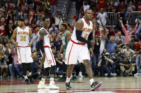 Apr 26, 2016; Atlanta, GA, USA; Atlanta Hawks forward Paul Millsap (4) and guard Dennis Schroder (17) react against the Boston Celtics in the third quarter in game five of the first round of the NBA Playoffs at Philips Arena. The Hawks defeated the Celtics 110-83. Mandatory Credit: Brett Davis-USA TODAY Sports