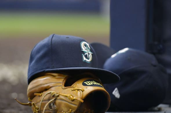 A Seattle Mariners hat is shown. The Everett AquaSox are the High-A affiliate.