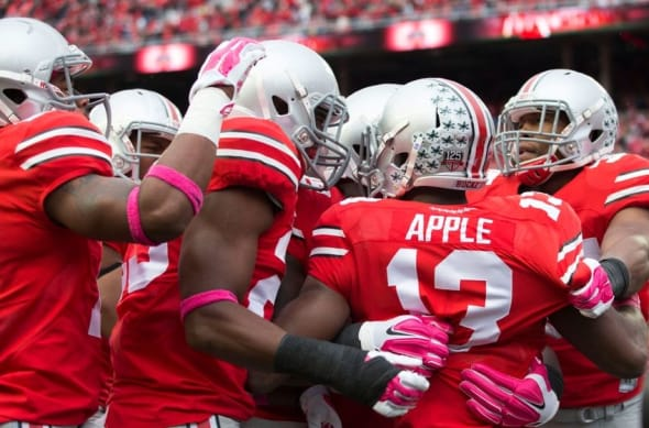 Oct 18, 2014; Columbus, OH, USA; The Ohio State Buckeyes defense celebrates a touchdown by cornerback Eli Apple (13) against the Rutgers Scarlet Knights at Ohio Stadium. Mandatory Credit: Greg Bartram-USA TODAY Sports