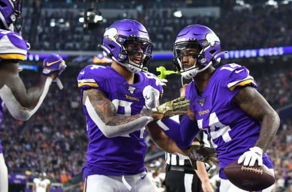 MINNEAPOLIS, MN - NOVEMBER 17: Minnesota Vikings Wide Receiver Stefon Diggs (14) celebrates his 54-yard touchdown reception from Minnesota Vikings Quarterback Kirk Cousins (8) with Minnesota Vikings Tight End Irv Smith (84) during the 4th quarter of a game between the Denver Broncos and Minnesota Vikings on November 17, 2019 at U.S. Bank Stadium in Minneapolis, MN.(Photo by Nick Wosika/Icon Sportswire via Getty Images)