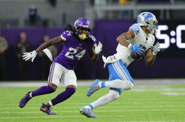 MINNEAPOLIS, MN - DECEMBER 08: Kenny Golladay #19 of the Detroit Lions makes a catch while Holton Hill #24 of the Minnesota Vikings attempts the tackle in the fourth quarter at U.S. Bank Stadium on December 8, 2019 in Minneapolis, Minnesota. The Minnesota Vikings defeated the Detroit Lions 20-7.(Photo by Adam Bettcher/Getty Images)
