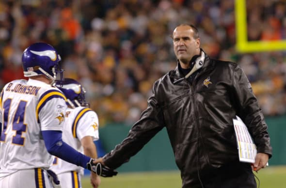 Minnesota Vikings coach Mike Tice congratulates quarterback Brad Johnson after a touchdown against the Green Bay Packers pass at Lambeau Field November 21, 2005 in Green Bay. The Vikings defeated the Packers 20 to 17. (Photo by Al Messerschmidt/Getty Images)