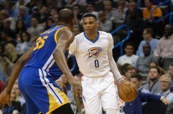 Feb 11, 2017; Oklahoma City, OK, USA; Oklahoma City Thunder guard Russell Westbrook (0) handles the ball in front of Golden State Warriors forward Kevin Durant (35) during the fourth quarter at Chesapeake Energy Arena. Mandatory Credit: Mark D. Smith-USA TODAY Sports