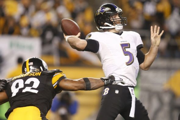 Jan 3, 2015; Pittsburgh, PA, USA; Baltimore Ravens quarterback Joe Flacco (5) throws the ball as Pittsburgh Steelers outside linebacker James Harrison (92) defends in the second quarter during the 2014 AFC Wild Card playoff football game at Heinz Field. Mandatory Credit: Charles LeClaire-USA TODAY Sports
