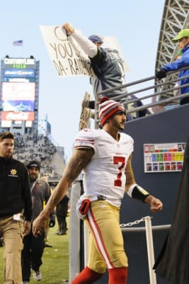 Dec 14, 2014; Seattle, WA, USA; San Francisco 49ers quarterback Colin Kaepernick (7) walks off the field after the game against the Seattle Seahawks at CenturyLink Field. Seattle defeated San Francisco 17-7. Mandatory Credit: Steven Bisig-USA TODAY Sports