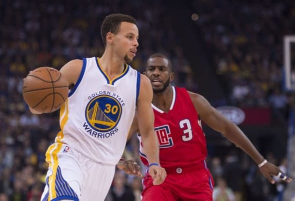 Mar 8, 2015; Oakland, CA, USA; Los Angeles Clippers guard Chris Paul (3) drives past Golden State Warriors guard Stephen Curry (30) in the first quarter at Oracle Arena. Mandatory Credit: Cary Edmondson-USA TODAY Sports