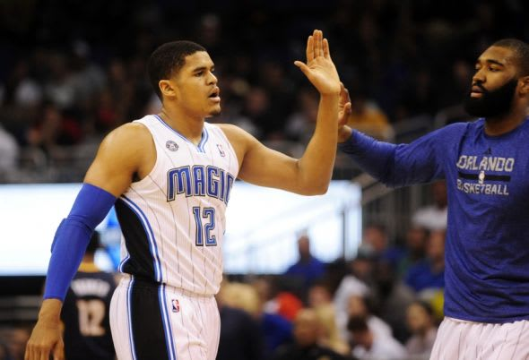 Apr 16, 2014; Orlando, FL, USA; Orlando Magic forward Tobias Harris (12) goes to high-five a teammate during a timeout in the first half against the Indiana Pacers at Amway Center. Mandatory Credit: David Manning-USA TODAY Sports