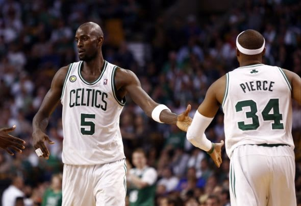 Apr 28, 2013; Boston, MA, USA; Boston Celtics center Kevin Garnett (5) and small forward Paul Pierce (34) celebrate against the New York Knicks during game four of the first round of the 2013 NBA playoffs at TD Garden. Mandatory Credit: Mark L. Baer-USA TODAY Sports
