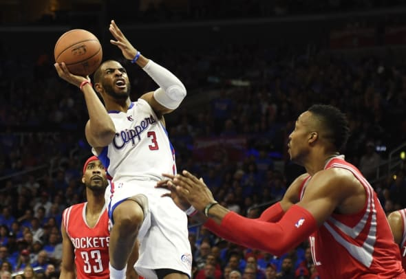 May 14, 2015; Los Angeles, CA, USA; Los Angeles Clippers guard Chris Paul (3) shoots over Houston Rockets center Dwight Howard (12) in game six of the second round of the NBA Playoffs at Staples Center. Mandatory Credit: Richard Mackson-USA TODAY Sports