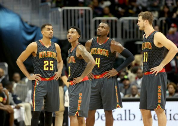 Oct 27, 2015; Atlanta, GA, USA; Atlanta Hawks guard Thabo Sefolosha (25, left), guard Jeff Teague (0), forward Paul Millsap (4) and forward Tiago Splitter (11) wait as officials review a play in the third quarter of their game against the Detroit Pistons at Philips Arena. The Pistons won 106-94. Mandatory Credit: Jason Getz-USA TODAY Sports