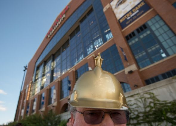Sep 13, 2014; Indianapolis, IN, USA; Mike Kasalo of South Bend, Indiana wears a hat with a miniature of the Notre Dame Golden Dome as he walks outside Lucas Oil Stadium before the game between the Notre Dame Fighting Irish and the Purdue Boilermakers. Mandatory Credit: Matt Cashore-USA TODAY Sports