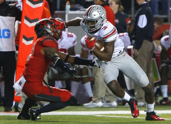 Oct 24, 2015; Piscataway, NJ, USA; Ohio State Buckeyes wide receiver Michael Thomas (3) stiff arms Rutgers Scarlet Knights defensive back Isaiah Wharton (11) before scoring a touchdown during first half at High Points Solutions Stadium. Mandatory Credit: Noah K. Murray-USA TODAY Sports