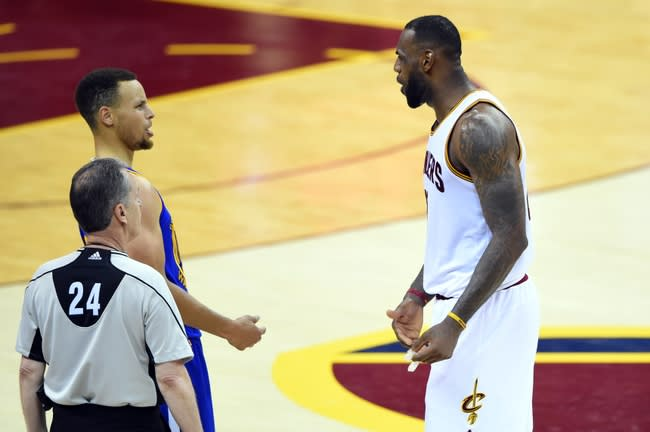 Jun 10, 2016; Cleveland, OH, USA; Golden State Warriors guard Stephen Curry (30) and Cleveland Cavaliers forward LeBron James (23) talks during the fourth quarter in game four of the NBA Finals at Quicken Loans Arena. Mandatory Credit: Bob Donnan-USA TODAY Sports