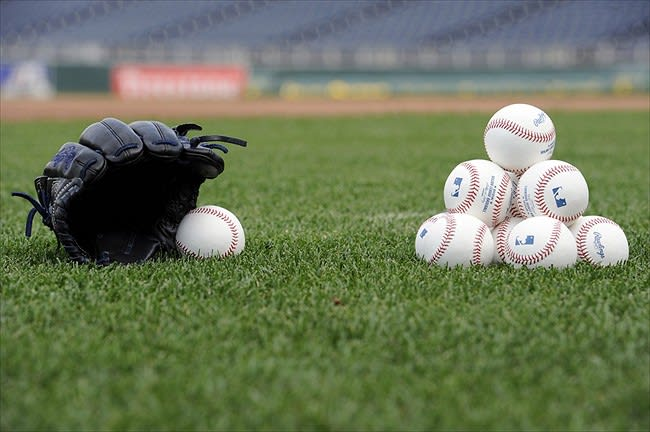 May 4, 2012; Kansas City, MO, USA; A stack of baseballs and a glove before a game between the New York Yankees and the Kansas City Royals at Kauffman Stadium. Mandatory Credit: Peter G. Aiken-USA TODAY Sports