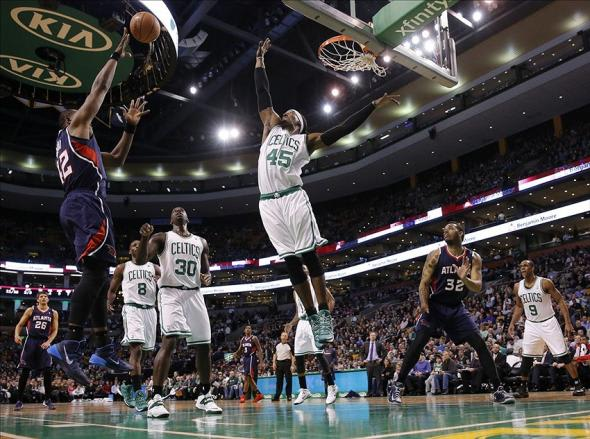 Feb 26, 2014; Boston, MA, USA; Boston Celtics small forward Gerald Wallace (45) defends against Atlanta Hawks power forward Elton Brand (42) in the first quarter at TD Garden. Mandatory Credit: David Butler II-USA TODAY Sports