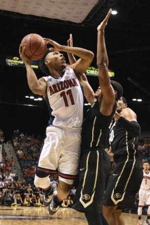 March 10, 2016; Las Vegas, NV, USA; Arizona Wildcats guard Allonzo Trier (11) shoots the basketball against Colorado Buffaloes guard George King (24) during the second half of the Pac-12 Conference tournament at MGM Grand Garden Arena. The Wildcats defeated the Buffaloes 82-78. Mandatory Credit: Kyle Terada-USA TODAY Sports