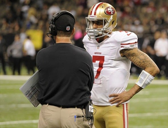 November 25, 2012; New Orleans, LA, USA; San Francisco 49ers head coach Jim Harbaugh talks with quarterback Colin Kaepernick (7) during fourth quarter of their game against the New Orleans Saints at the Mercedes-Benz Superdome. The San Francisco 49ers defeated the New Orleans Saints 31-21. Mandatory Credit: John David Mercer-USA TODAY Sports