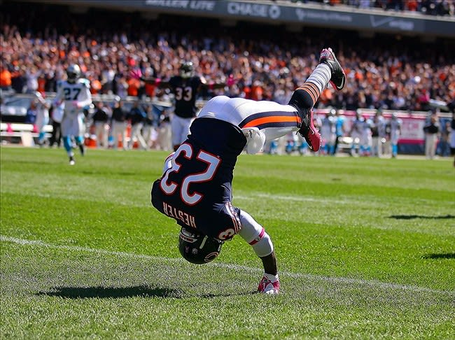 Oct 2, 2011; Chicago, IL, USA; Chicago Bears wide receiver Devin Hester (23) celebrates his 69 yard punt return for a touchdown during the second quarter against the Carolina Panthers at Soldier Field. Mandatory Credit: Dennis Wierzbicki-US PRESSWIRE