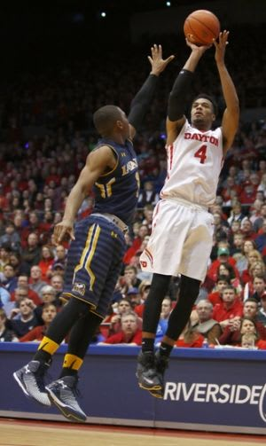 Dayton Flyers guard Charles Cooke (4) helped the team overcome the graduation of Jordan Siebert and the suspension of Dyshawn Pierre. Mandatory Credit: David Kohl-USA TODAY Sports