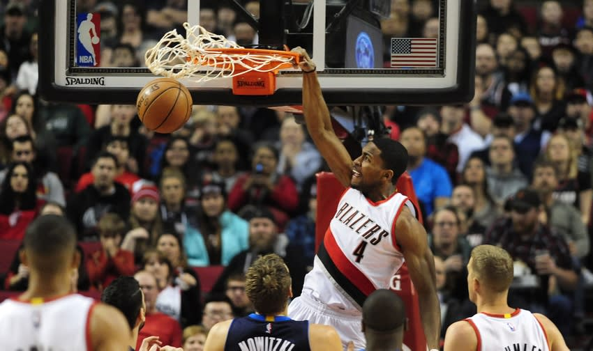Mar 23, 2016; Portland, OR, USA; Portland Trail Blazers forward Maurice Harkless (4) dunks the ball against Dallas Mavericks forward Dirk Nowitzki (41) during the first quarter of the game at Moda Center at the Rose Quarter. Mandatory Credit: Steve Dykes-USA TODAY Sports