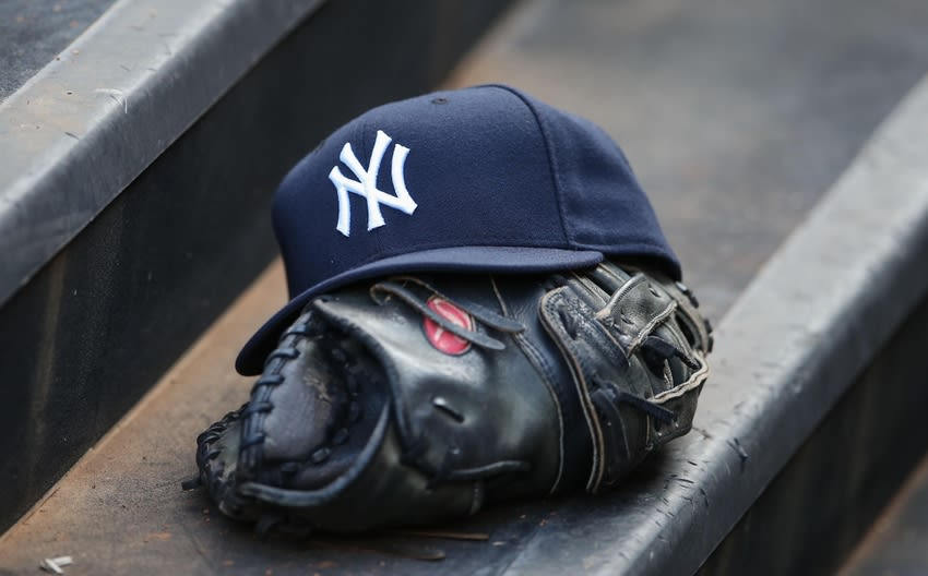 Jul 24, 2013; Arlington, TX, USA; New York Yankees hat and glove sit on the dugout steps during the game against the Texas Rangers at Rangers Ballpark in Arlington. Texas won 3-1. Mandatory Credit: Kevin Jairaj-USA TODAY Sports