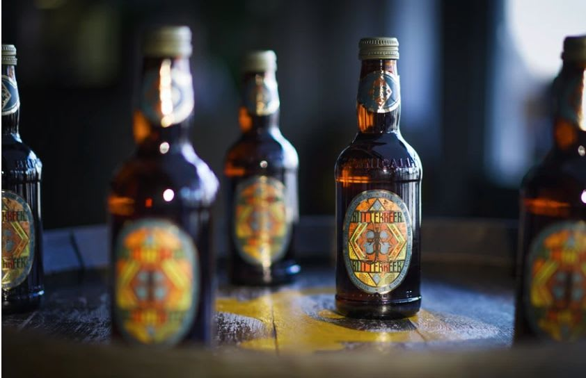 The 'Harry Potter' Warner Bros. Studio Tour London has released bottled Butterbeer in the UK. The label is designed by the props team, MinaLima.