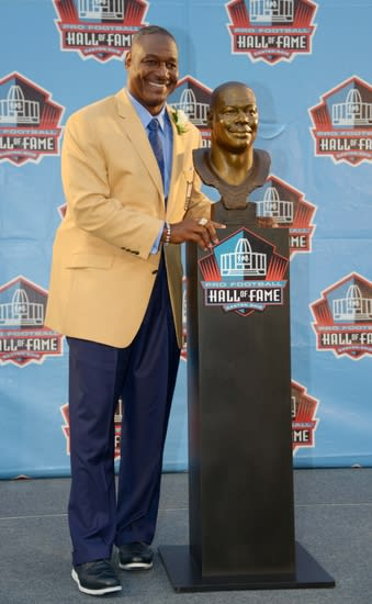 Aug 2, 2014; Canton, OH, USA; Derrick Brooks poses with his bust at the 2014 Pro Football Hall of Fame Enshrinement at Fawcett Stadium. Mandatory Credit: Kirby Lee-USA TODAY Sports