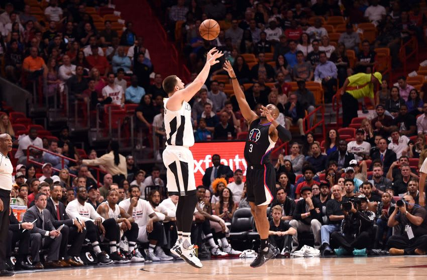 Dec 16, 2016; Miami, FL, USA; Miami Heat forward Josh McRoberts (4) shoots over Los Angeles Clippers guard Chris Paul (3) during the first half at American Airlines Arena. Mandatory Credit: Steve Mitchell-USA TODAY Sports
